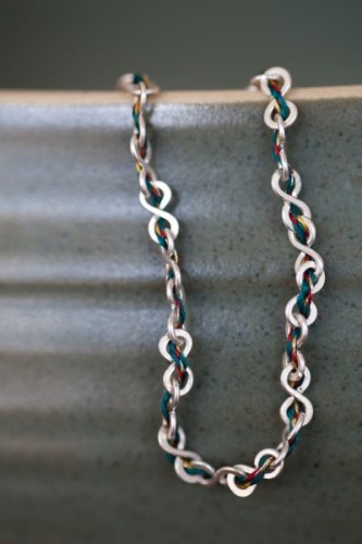 Dignify unchained silver necklace