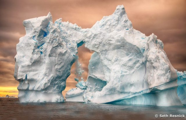 Iceberg collapse. Photographed by Seth Resnick during our Antarctica Photography Workshop
