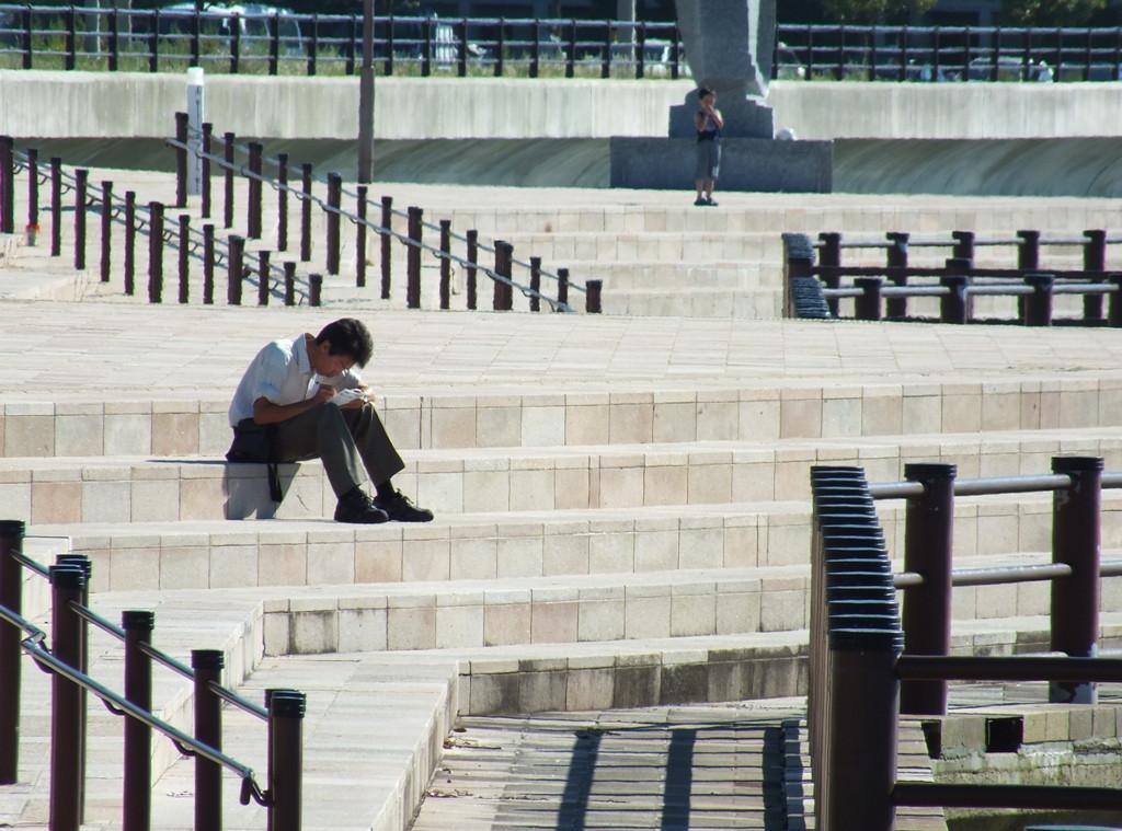 Man sitting in Sunport