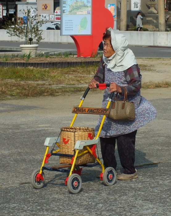 An old lady and her Onba on Ogijima.