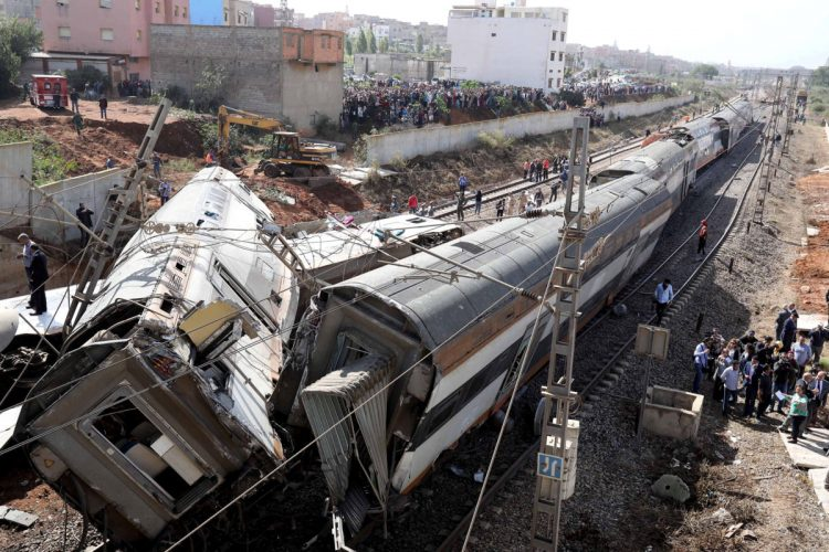 Security personnel are seen at the site of a train derailment at Sidi Bouknadel near Rabat