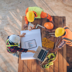team-engineer-architects-working-meeting-discussing-designing-planning-measuring-layout-building-blueprints-construction-site-top-view-construction-concept_64073-178