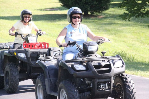 Women ride ATVs at the Becoming an Outdoors-Woman workshop.