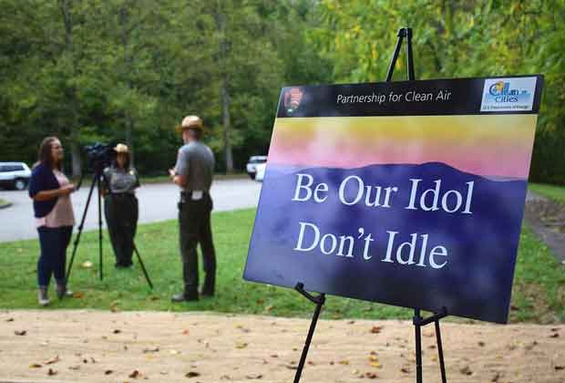 "Great Smoky Mountains National Park signs ""Be our idol, Don't Idle."""