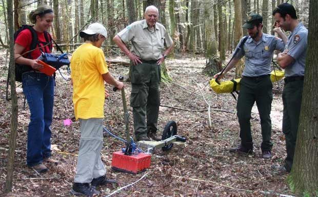 Bob Lochbaum (center) assisting with ground penetrating radar survey in Cades Cove.