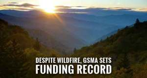 """Great Smoky Mountains Association had its best year ever for both sales and membership income in 2016, allowing the association to contribute more than $2 million in support to Great Smoky Mountains National Park last year. """"We continued our focus on retail sales, publications and customized product development, and membership development, throughout the year,"""" Executive Director Laurel Rematore said this week. """"And just when we thought we'd end the year with no major events to mention – other than record-setting visitation – we experienced the late November wildfires that shut down the park for several days and destroyed nearly 2,500 structures in Gatlinburg."""" Great Smoky Mountains Association immediately responded to the tragedy and successfully raised more than $200,000 from members and others to assist park employees, volunteers, and affiliates who had lost their homes, she continued. Despite the wildfires, some 11,312,785 people visited the Smokies in 2016, which was likely influenced by low fuel prices, an improving economy, and the """"Find Your Park"""" multimedia campaign to mark the NPS Centennial. As operator of the park's visitor center stores, Great Smoky Mountains Association also experienced a record-setting sales year. """"Great Smoky Mountains Association continues to provide critical support that enables us to not only serve our visitors better, but also to provide unique opportunities in bringing the parks to people,"""" said Superintendent Cassius Cash. """"In the spirit of the National Park Service Centennial, they helped us attract new audiences to all public lands in our region through the award-winning Airport Park exhibit and support of our Centennial Ambassadors."""" The organization's aid-to-park funding in 2016 was $2,005,787, capping another strong year of support. It's contributions to Great Smoky Mountains National Park fall into three broad categories: cash donations, which are provided for a host of educational, historical, interpretive, and scientifi"""