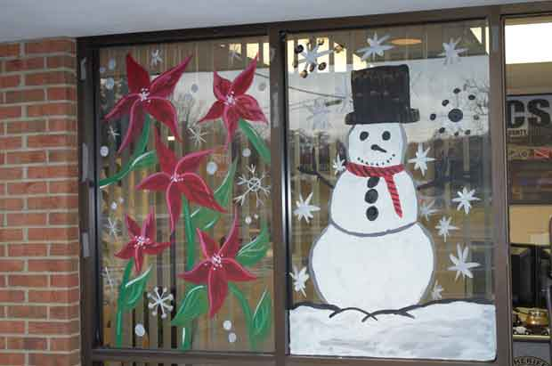 Local Art Students Decorate Special Operations Center Windows for Holidays