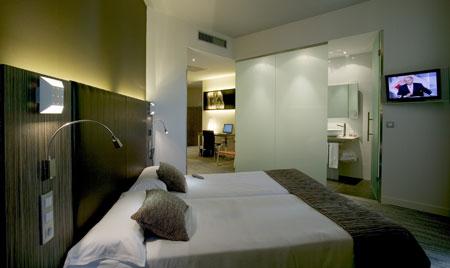 living room mini bar red curtain in hotel petit palace santa cruz, 4 star seville