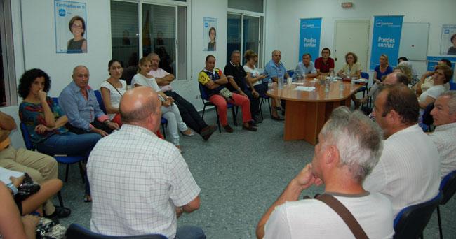 Reunión de comerciantes en la sede del PP de Alcalá