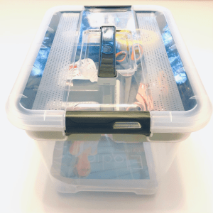 Plastic sewing box with equipment inside