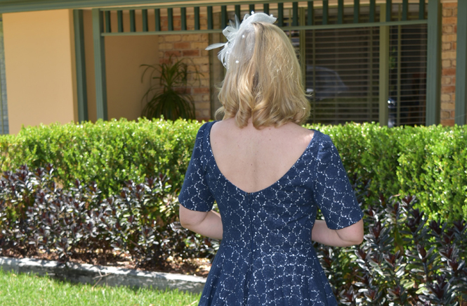 Dress for a wedding and stabilizing a low back neckline.
