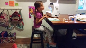 When my 6 year old daughter sews with me, I place the foot pedal on a bathroom stool so that she can reach it while she sews.