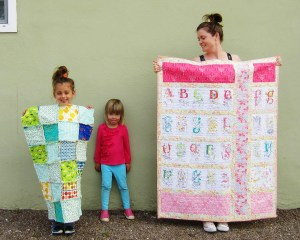 Here is my then five year old daughter showing off the rag quilt she helped to sew.