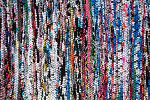 Take scraps and make a woven rag rug with a wonderful and colorful texture!