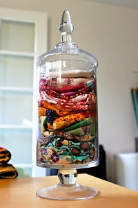 The most fitting right now is the notion of keeping excess fabric pieces in a jar.