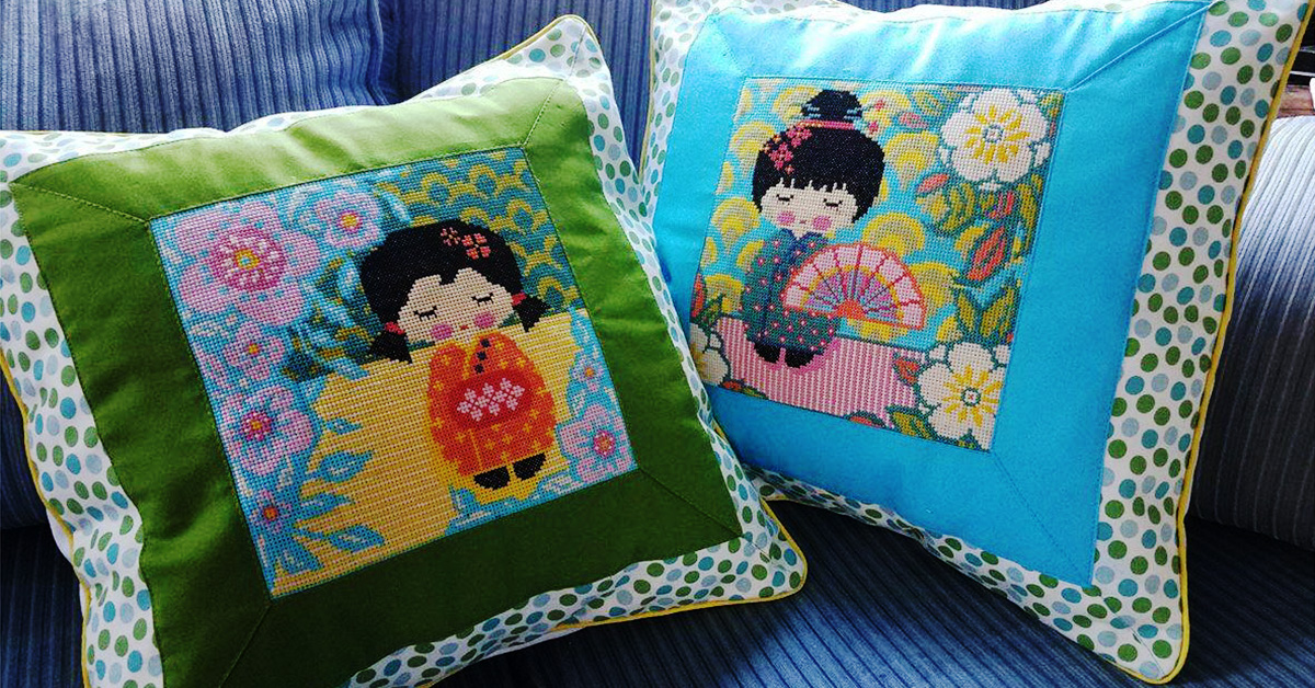 Cross Stitch Panel Pillows with Mitered Fabric Framing