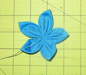 Sew the last petal to the first, then neaten center.