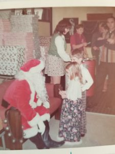 Mom made long skirt and plaid pants for Santa visit. My brother and I were very stylish.