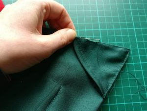Hand-Stitching the Pockets for the Net Curtain Rod to the Back of the Advent Calendar