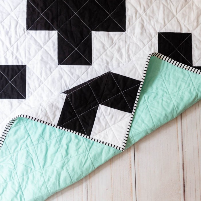 pictured: black and white cross pattern with mint green background