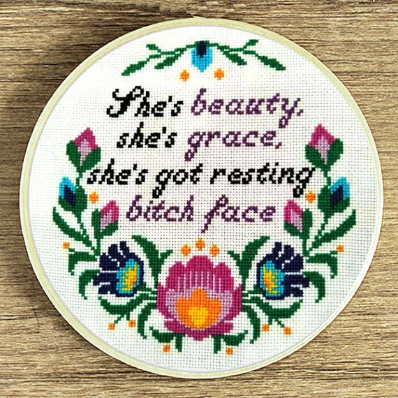 pictured cross stitch hoop with words she's beauty she's grace she's got resting bitch face