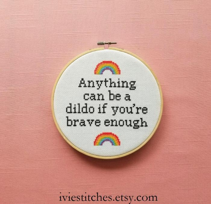 pictured cross stitch hoop with rainbows and words reading anything can be a dildo if you're brave enough
