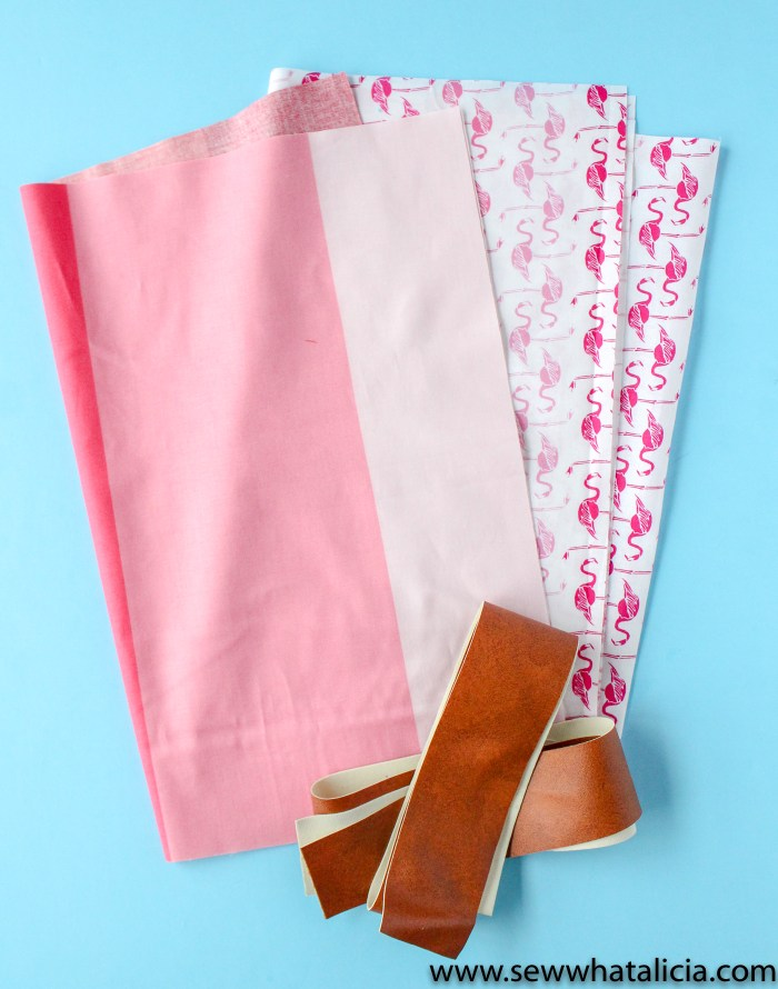How to Make a Tote Bag: Supplies pictured, four pieces of fabric and two leather handles. | www.sewwhatalicia.com