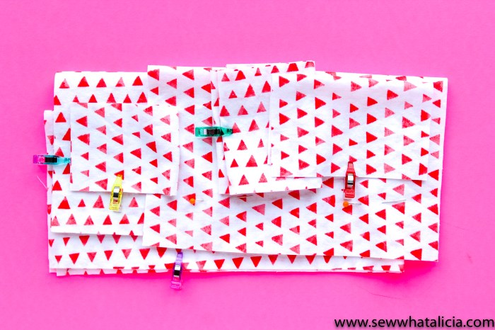 Scrappy Easy Rainbow Quilt Pattern and Tutorial: Pictured cut white pieces color coded with mini wonder clips. | www.sewwhatalicia.com