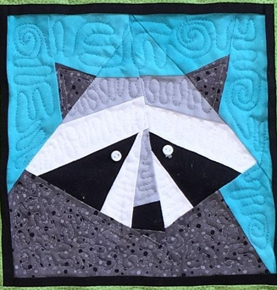 pictured finished raccoon quilt block