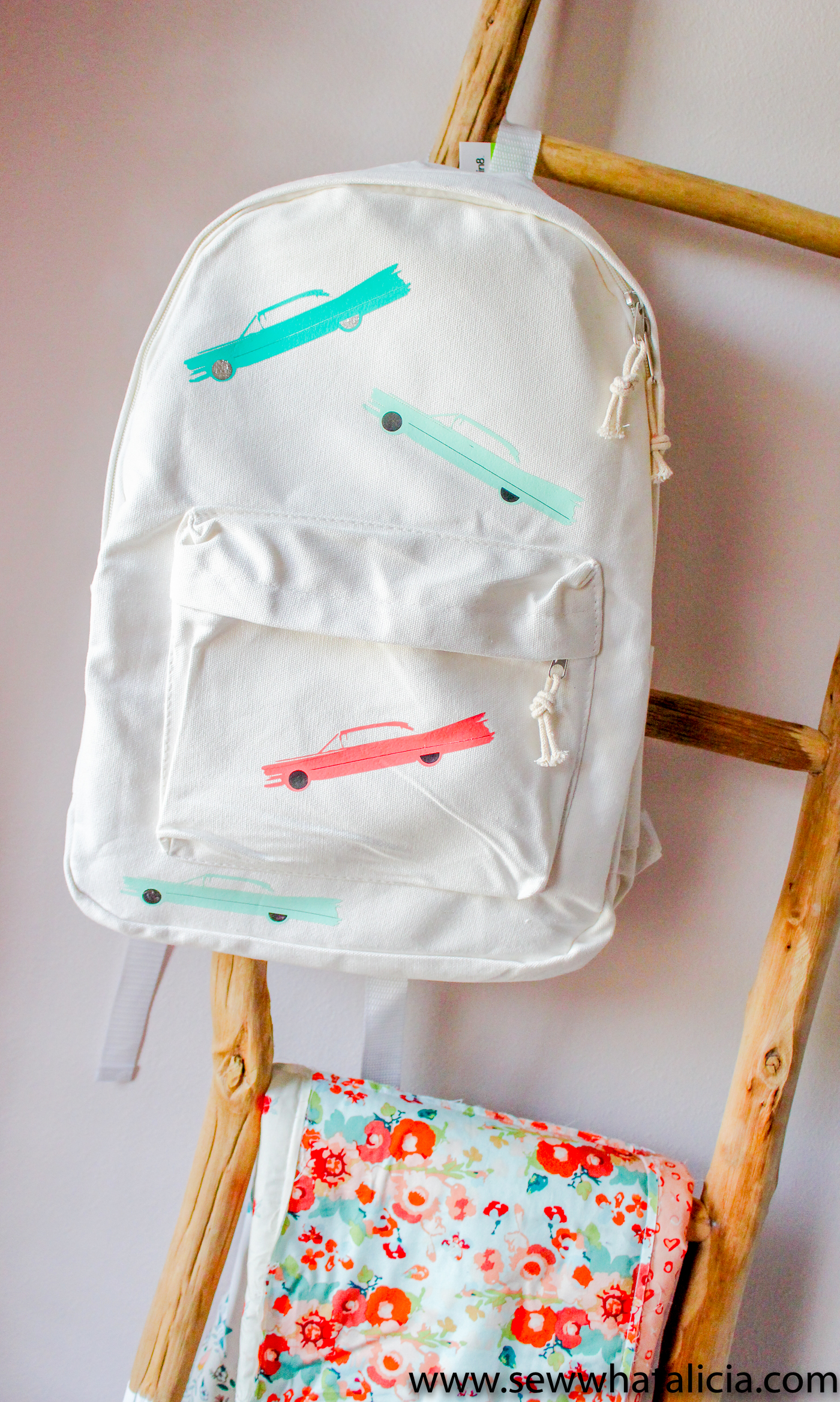 Tips for layering heat press vinyl: create this adorable backpack by layering heat transfer vinyl. Click through for all the tips plus info on the palm springs cut file bundle used to create this project. | www.sewwhatalicia.com