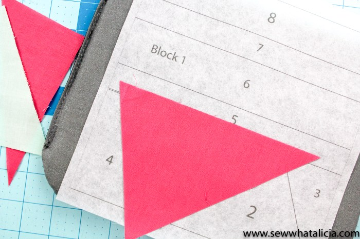pictured: pink triangle covering the 1 spot on the printed quilt template