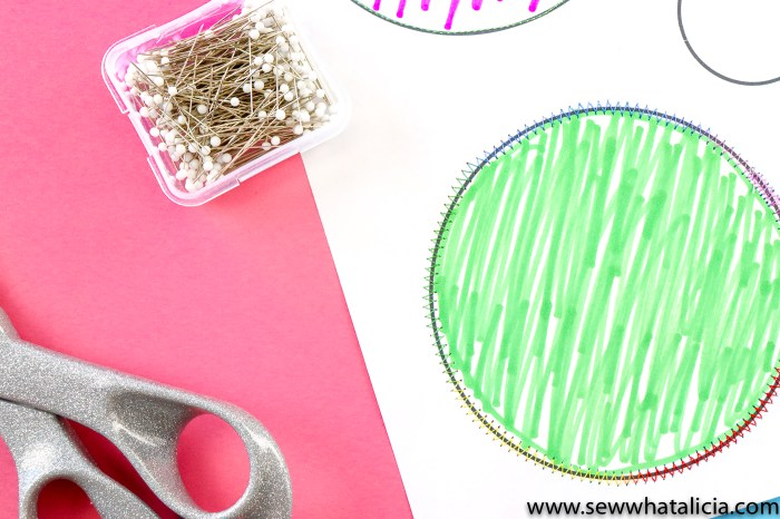 pictured: half of a printable sewing sheet, circles colored in, with pins and scissors