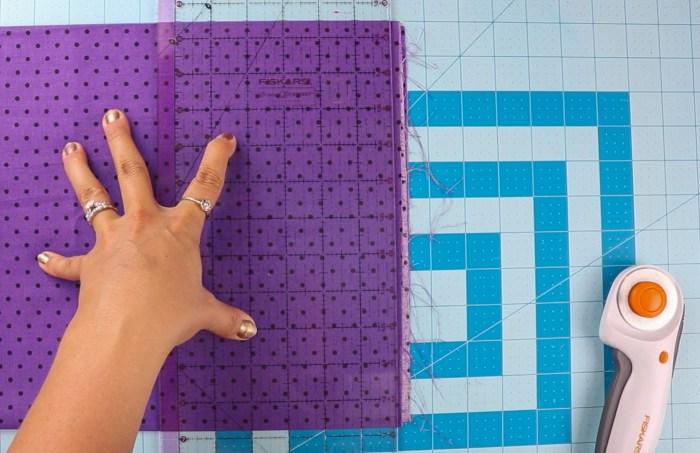 pictured: cutting mat with fabric and ruler before cutting