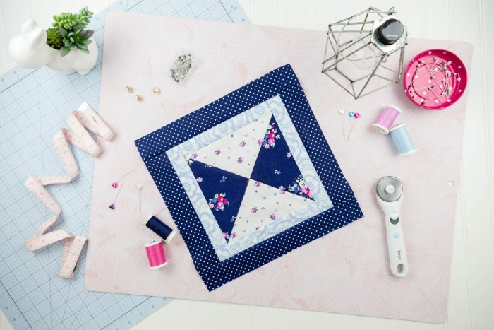 pictured hourglass quilt block, rotary cutter, and various sewing notions