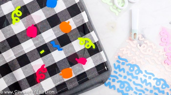 pictured cloth napkin with varying colors of vinyl shapes on top.