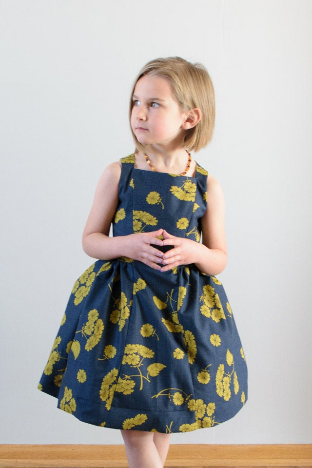 pictured young girl in spelen dress