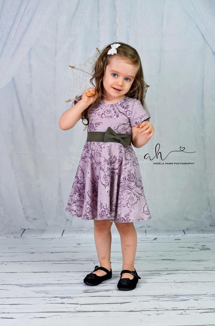 pictured girl in maci dress