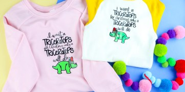 pink shirt and white and yellow baseball shirt with triceratops and lyrics ironed on