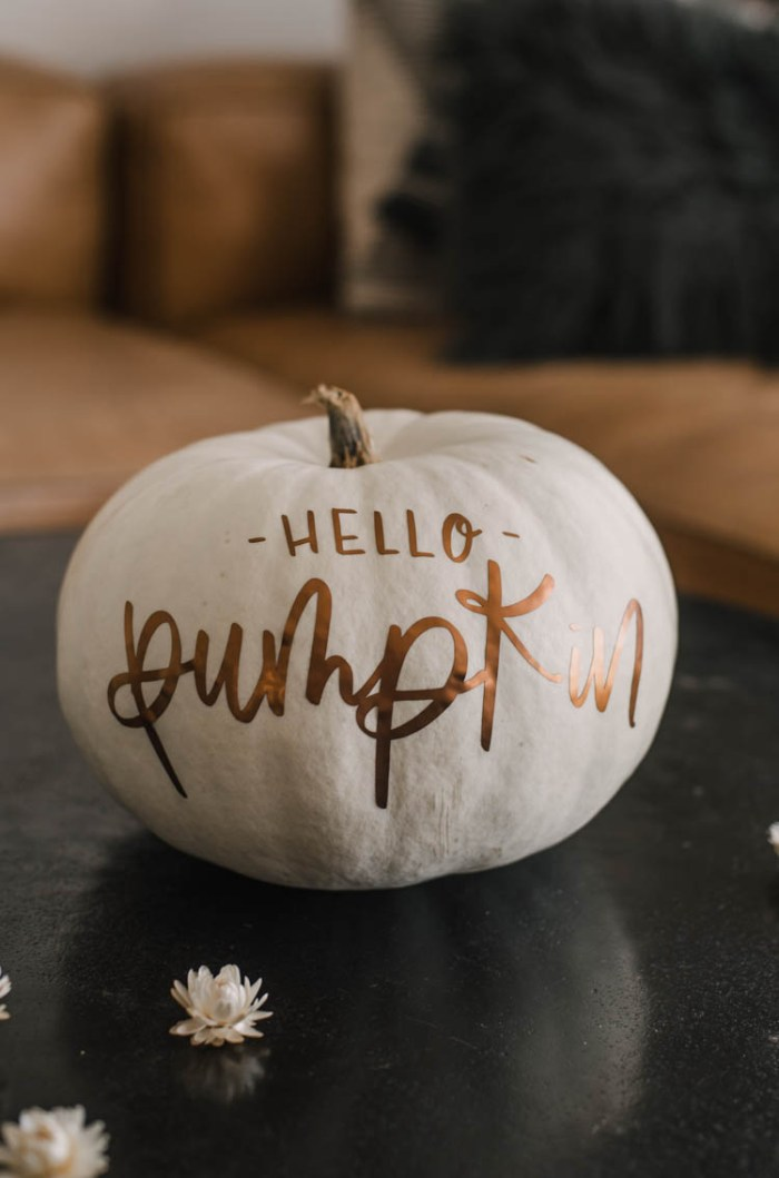 white pumpkin with vinyl saying on it