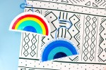 pictured two rainbow ornaments one in blue scale