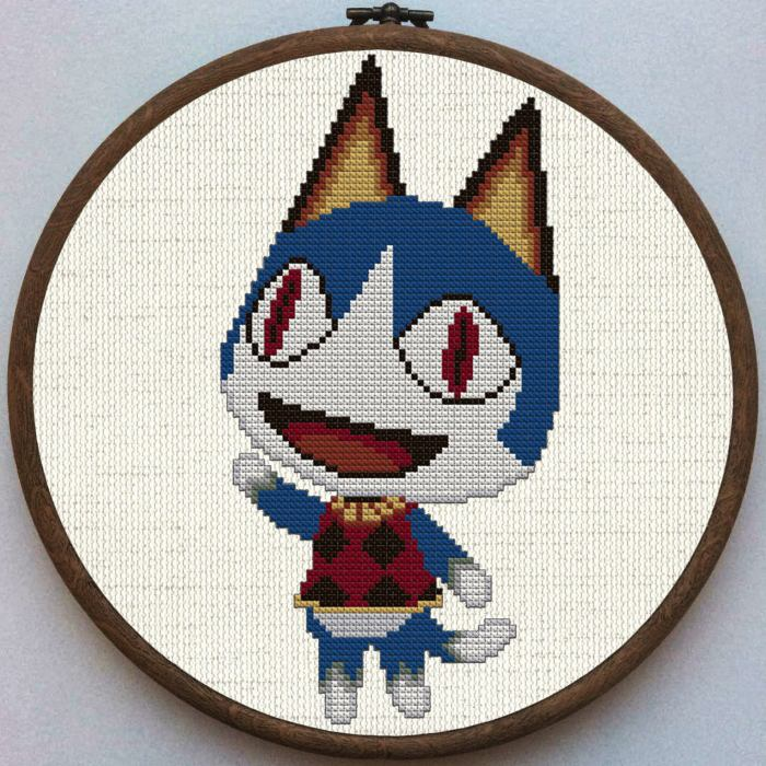 pictured rover from animal crossing done in cross stitch