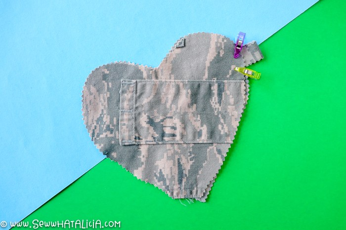 pictured two hearts with strip clipped between layers