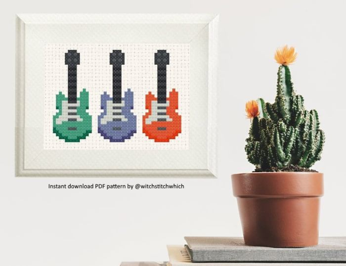 pictured digital mockup of guitar cross stitch project next to a planted cactus