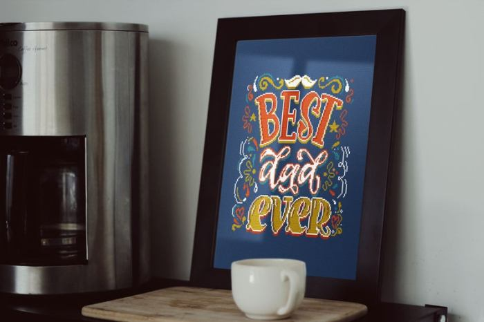 pictured best dad ever cross stitch project staged with a coffee cup