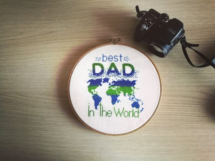 pictured finished cross stitch with map and words best dad in the world