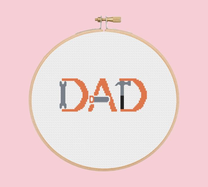 pictured cross stitch word dad made from tools