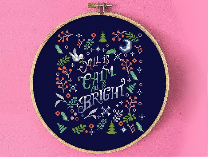 christmas cross stitch sampler with words all is calm all is bright