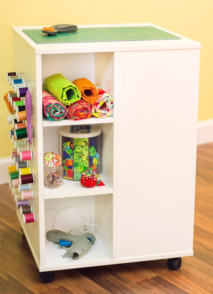storage cube with wheels and shelves on one side, with yarn storage on another side