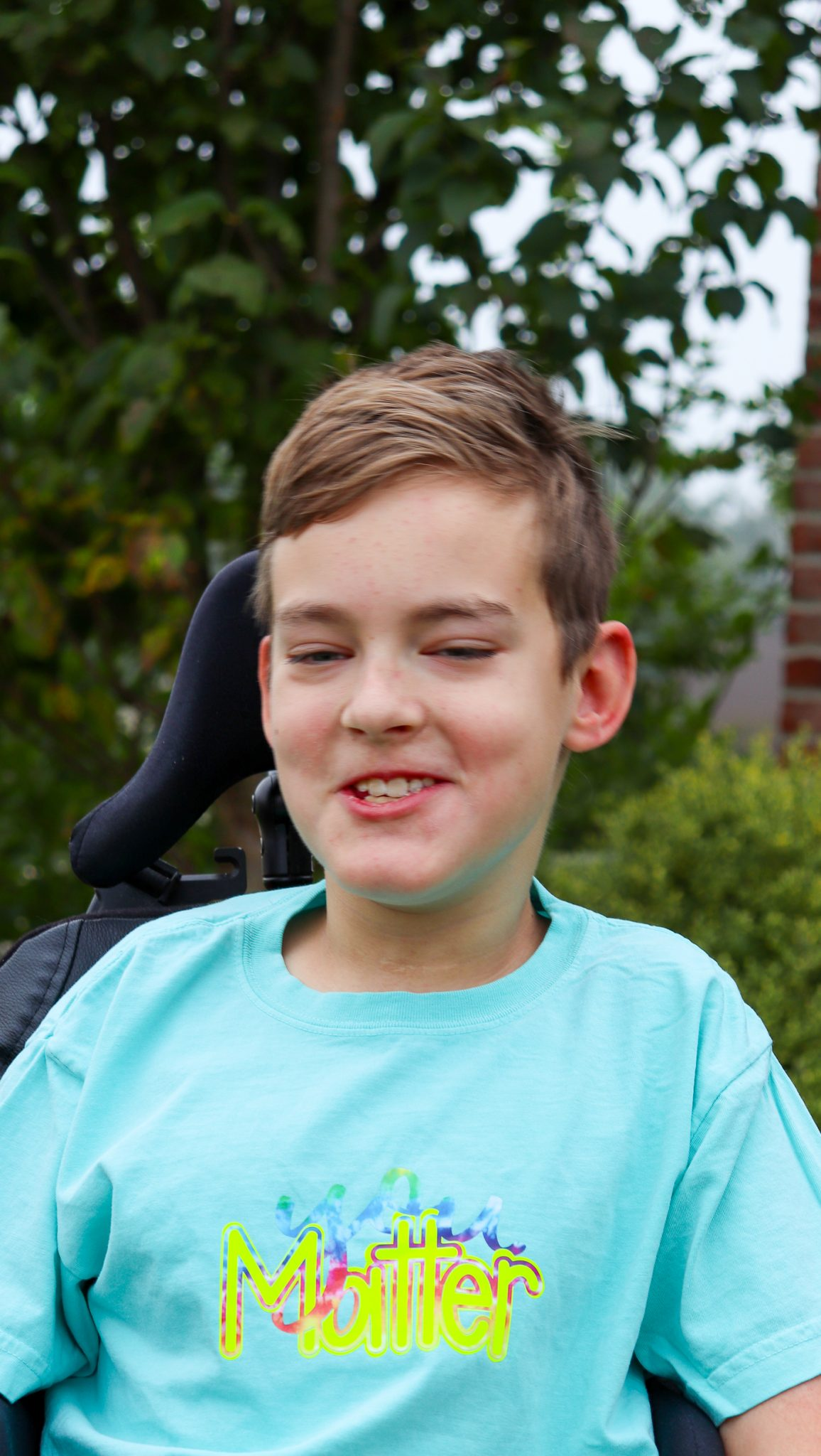 boy in wheelchair wearing shirt with words you matter on the front