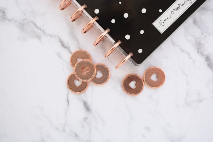 rose gold discs with hearts cut out
